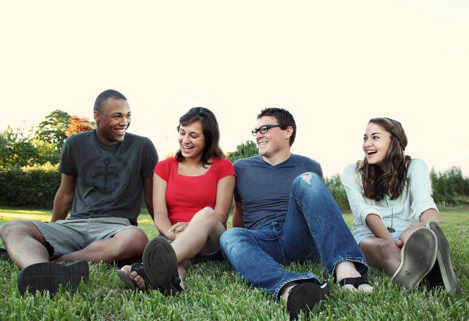 A group of friends sitting on grass