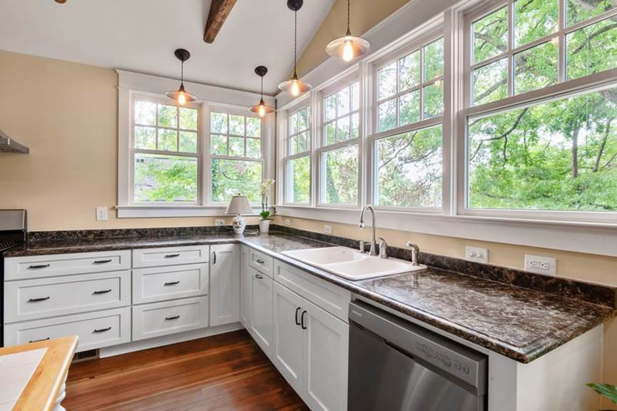 A beautifully designed, functional kitchen with various appliances included.