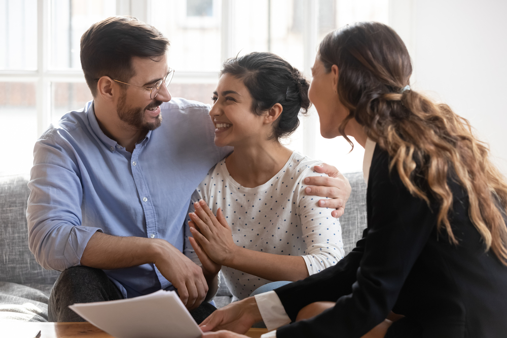 Couple making a decision with agent