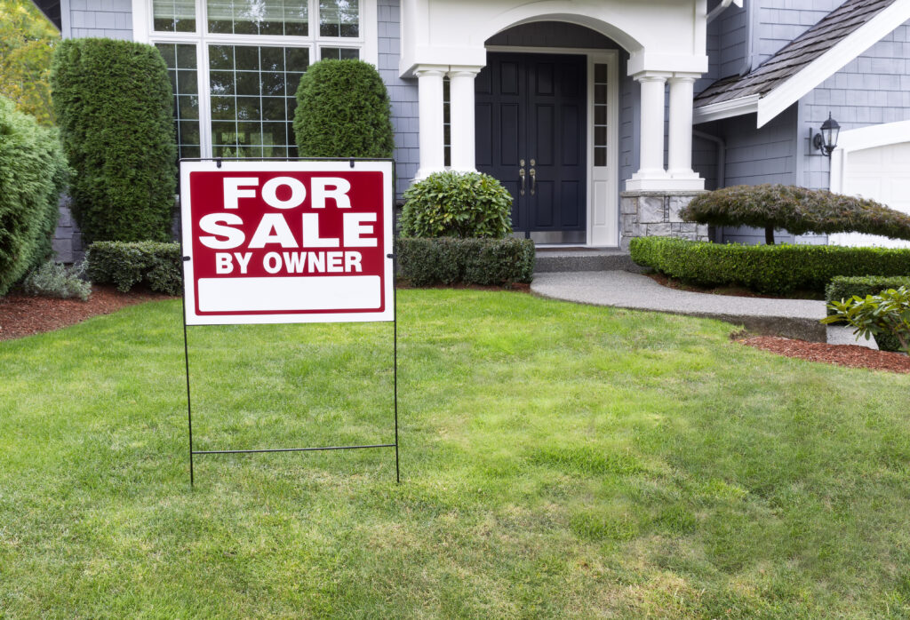 For Sale by Owner sign in yard