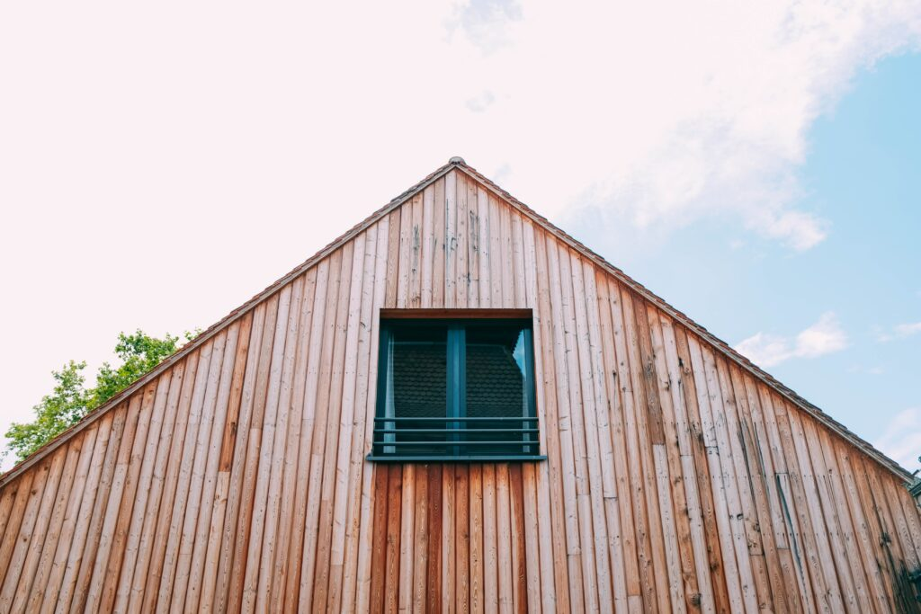 wooden house with an attic window
