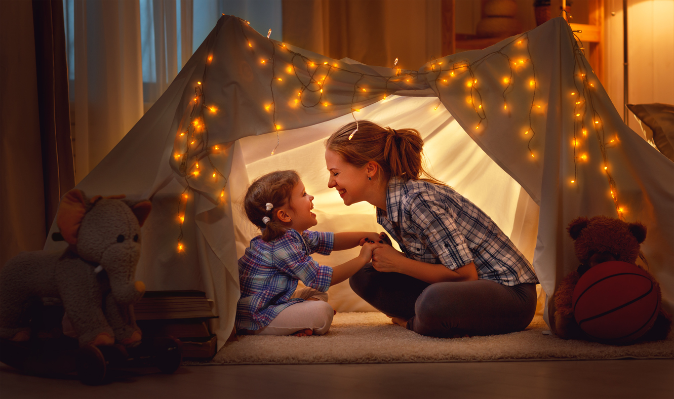 Mother and child in living room tent