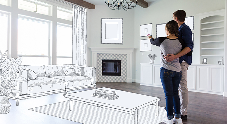 A young couple stand in the empty living room of their new home and imagine the room decor and furniture placement.