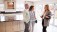 Realtor Showing Couple Interested In Buying Around House