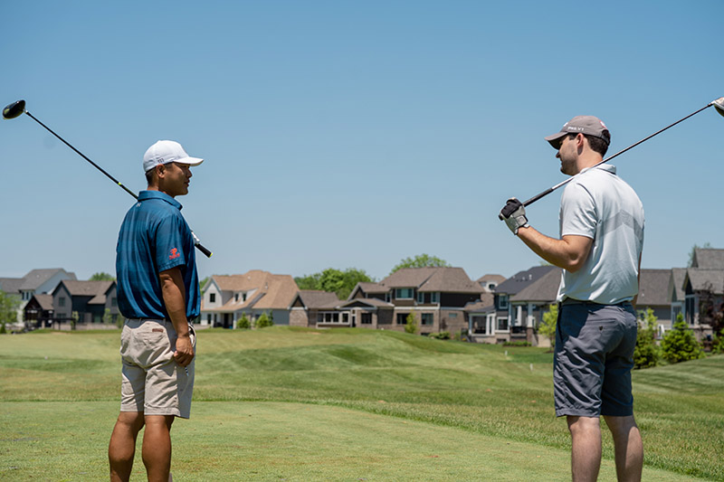 Golfers in view of residential community at World Golf Village