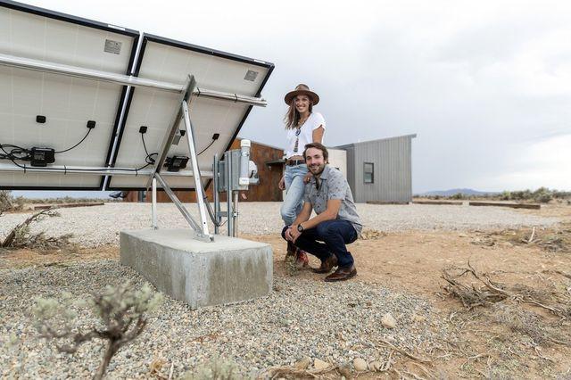 Austin and Randall Slimp by their solar array.