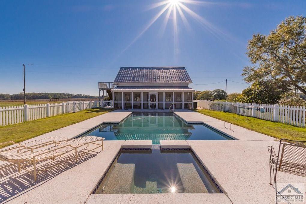 Pool and pool house in Newborn, GA farmhouse.