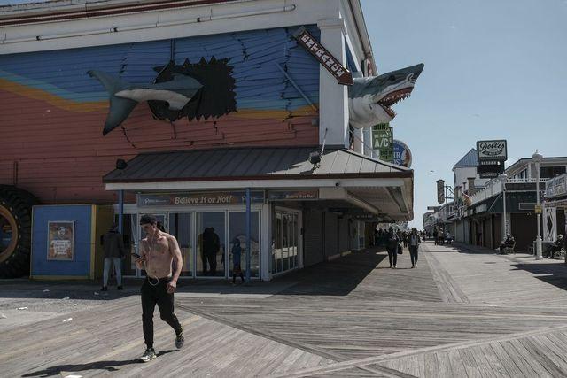 Visitors walk along the boardwalk in Ocean City, Md., on May 13.