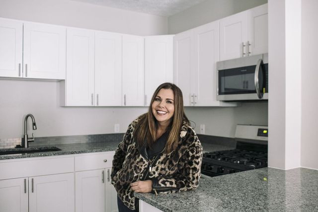 Ms. Stumphauzer in the renovated kitchen of a rental house she flipped to an investor.