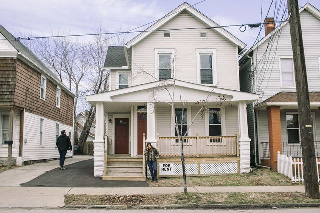 Ms. Stumphauzer in front of a home she renovated in Cleveland's Tremont neighborhood.