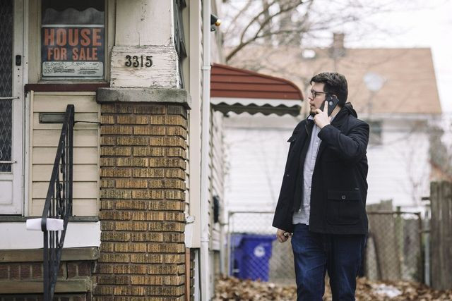 Nico Vonderau, who works with Ms. Stumphauzer, checks out a run-down house for sale.