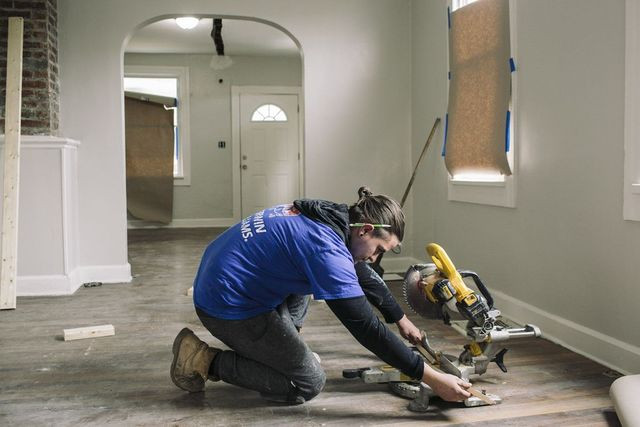 Contractor Juan Gonzales works on a home owned by Ms. Stumphauzer.