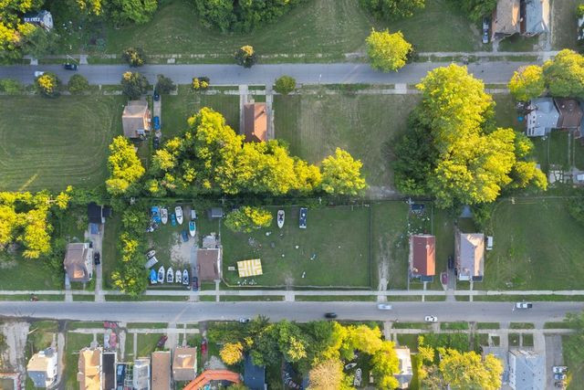 Vacant lots are common in Detroit just a block from the border between the city and Grosse Pointe Park.