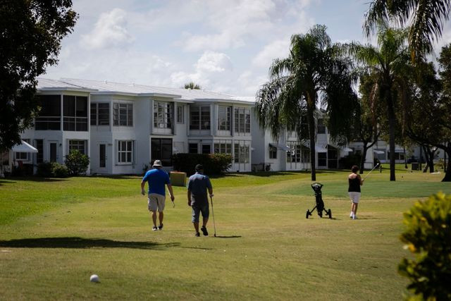 Seniors play golf at Leisureville, an age-restricted senior community, in Pompano Beach, FL.