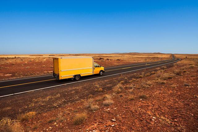 A moving van drives through the desert in Arizona.
