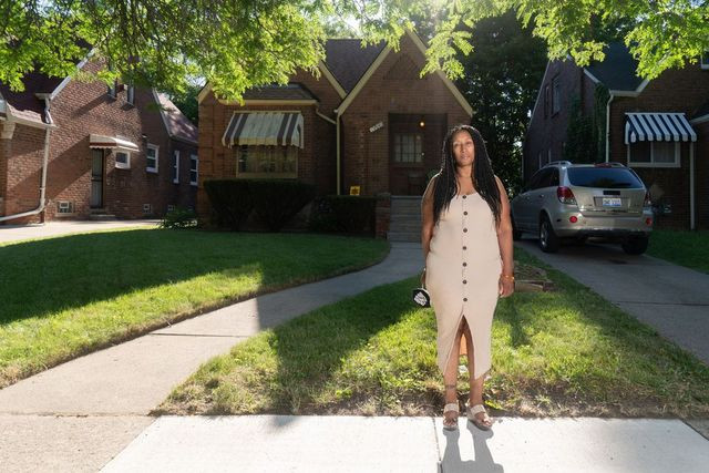 Alicia Lurry in front of her home on the west side of Detroit.