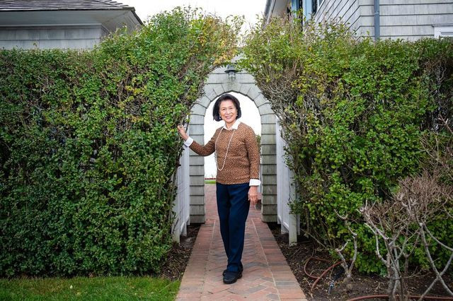 Loida Lewis outside the home in East Hampton, N.Y., that was a haven for her and her family during the pandemic .