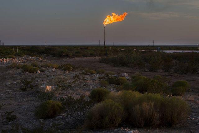 A gas flare burning in a field near Mentone, Texas