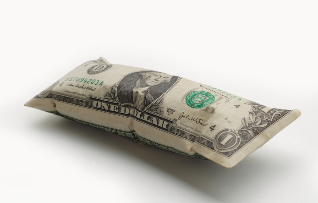 Dan Hamilton explains inflation using this image of a dollar bill inflated like a balloon.