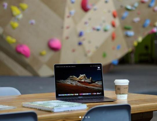 Remote work in a rock climbing gym.