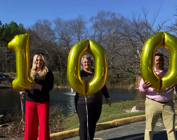 100th Home Sold Give Back Team