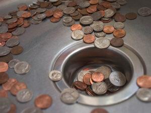 Coins in drain