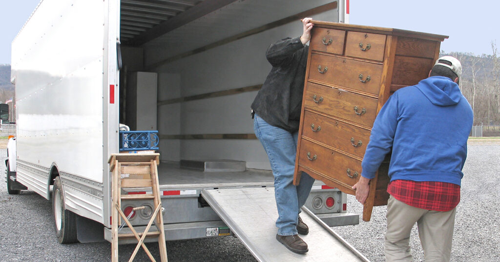 people on moving truck
