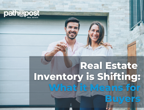 A happy couple outside of their newly bought home; a photo showing a concept of shifts in real estate inventory.