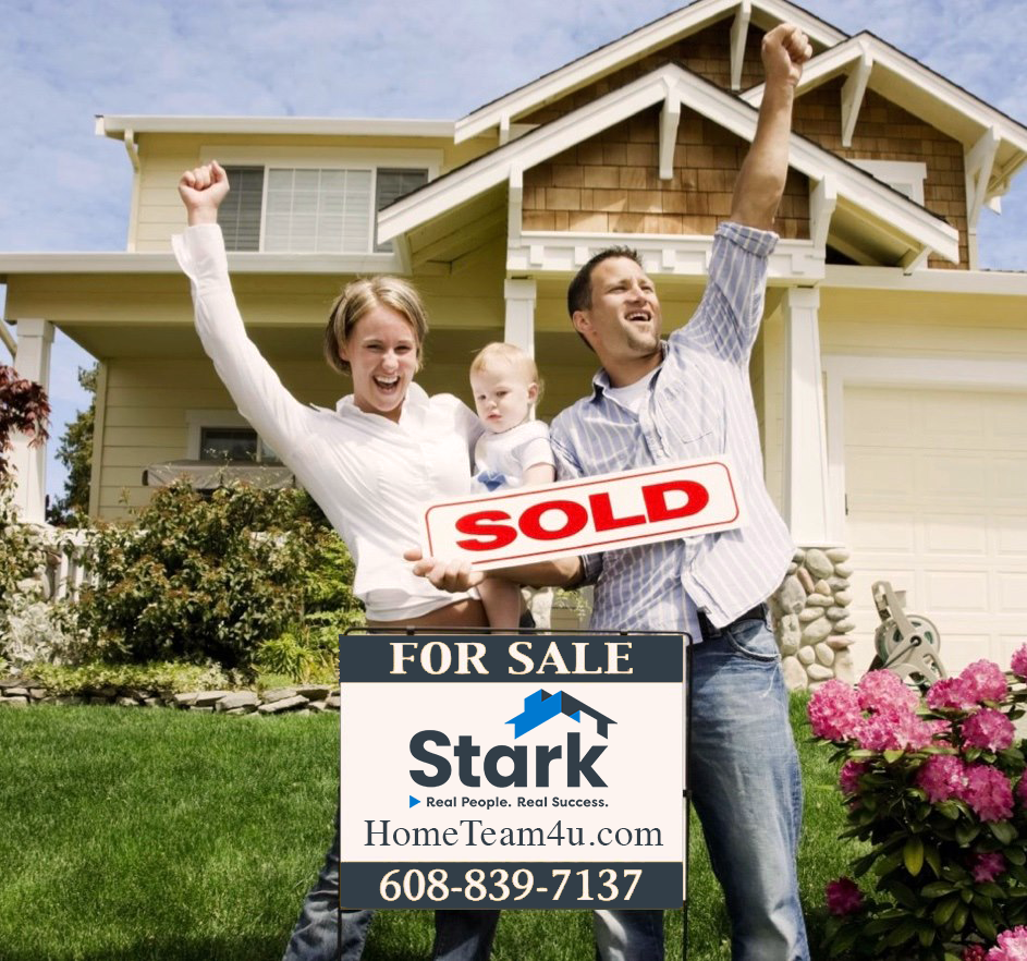 first time home buyers holding for sale sign