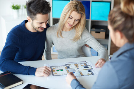 ouple meeting with real estate agent